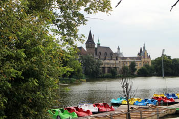 colorful rowing boat in the lake, vajdahunyad castle in the background