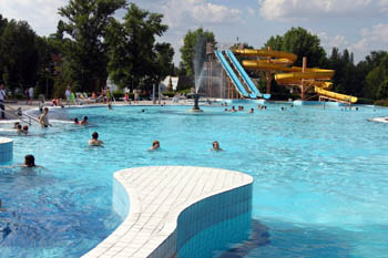 a large leisure pool and a giant slide in the background at Csepel lido