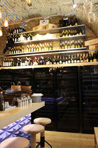 shelves stocked with wine in the vaulted DOC wine Bar in downtown Pest