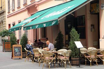a cafe terrace with green tents