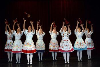8 women performing bottle dance