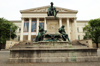 front view of Petofi Sandor poet's bronze statue in front of the musuem building