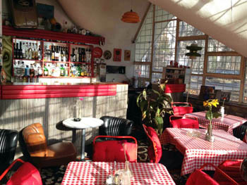 red-white checkered tables inside the bistro