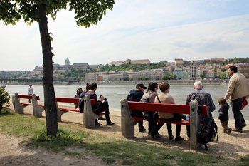 People on benches on the Danube promenade