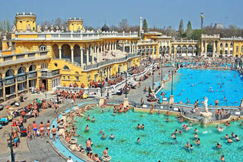 bird's eye view of the outdoor pools and the yellow building