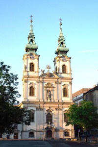 front view of the two-towered church on a summer day