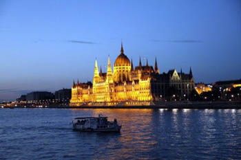 a crusie boat Danube at the Parliament at the blue hour