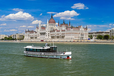 a white sightseeing ship plying the Danube