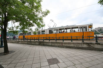 a yellow tram car