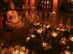 a large Buddha Statue inside the hotel