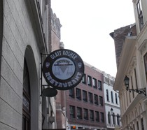 the round name plate of the restaurant