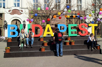Budapest captioned from colorful letters in front of the Gerbeaud cafe