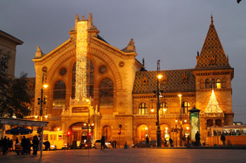 the Great Market Hall's facade illuminated at night