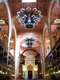 the richly decorated ceiling and the chandelier
