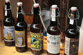 5 bottled craft beers on a wood table