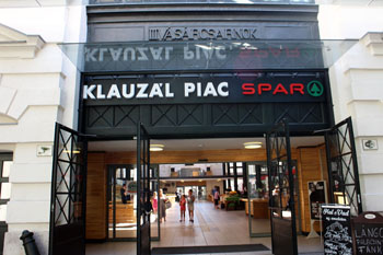the entrance to the market with a Spar logo