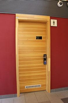 the wooden door of the toilet