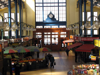 the interior of the market with a clock above the entrance door