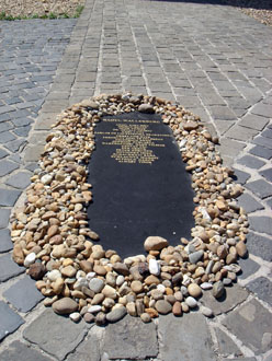 the black marble memorial of Raoul Wallenber surrounded with stones left by visitors