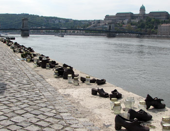 pairs of old-fashione dcats iron shoes on the danube bank, Chain bridge and Bud aPalac ein the background