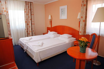 a double room with a double bed with white bedlinen on it