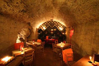 the rustic stone interior of the vaulted cellar