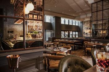 the dark brown and beige interior of the Deak St. Kitchen