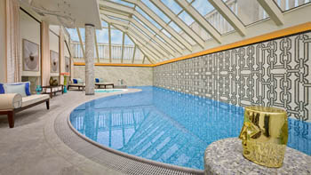 the half-circle shaped swimming pool in the spa