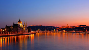 light blue skyline tinted with pink aand orange over the Budapest