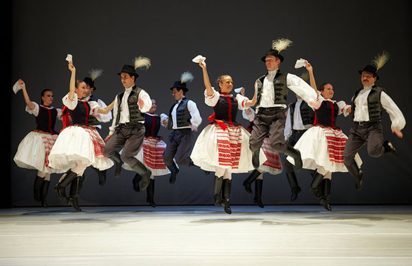 folk dancers performing on stage