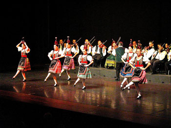 the hungaria Folk Ensemble performing a bottle dance, dancers dressed in folk costume