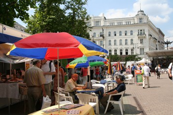 exhibitors under colourful shade umbrellas at the bookweek on Vorosmarty sqr.