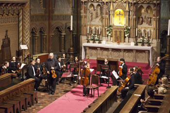 an orchestra playing at the main altar