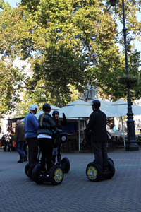 4 segway riders on a square