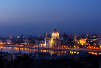 the Parliament illuminated and the Danube at dusk