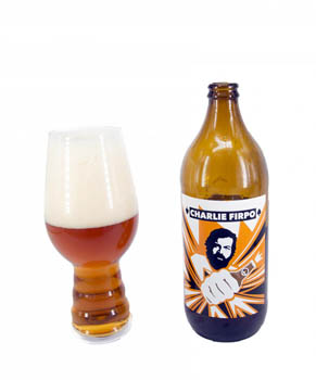 Charlie Firpo beer in bottle with a mug full of beer to its left