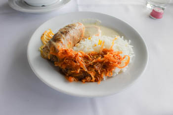 stuffed cababge with rice on a round white plate