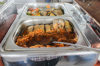 stuffed cabbage in a stainless steel container-buffet table
