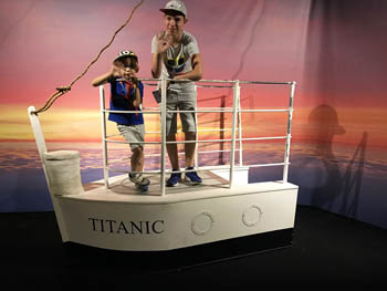 our 2 boys (aged 6 and 13) on mockup stern of the Titanic