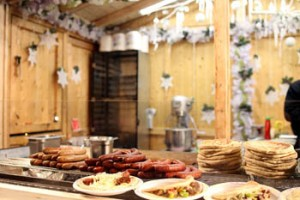 roasted sausages and other food in a wooden cottage