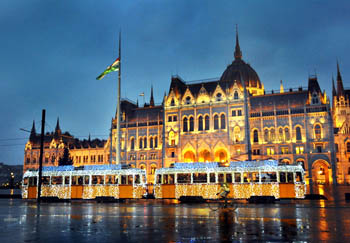 the light tram in front of the Parliament at the blue hour