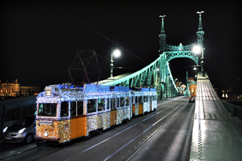 tram 47 with the festive lights on the green Liberty Bridge at night