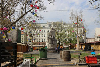 the square in spring time with the marble statue of M. Vorosmarty