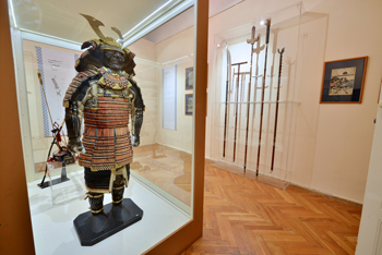 a samurai warrior in a glass display cabinet