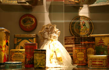 plates and various utensils behind a display cabinet
