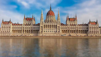 front view of the parliament from the Buda side on a sunny day