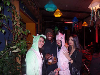 3 girls and a black man in a bra, 2 girls dressed in Halloween costume