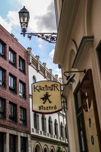 the logo of the Kazimir bistro hanging above the entrance