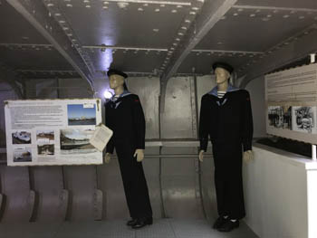 two life size figures dressed in naval officer suit