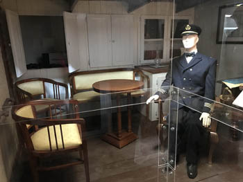 the interior of the ship captain's bedroom